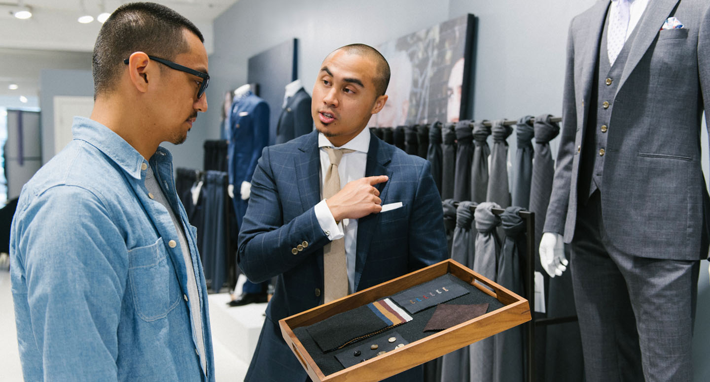 An INDOCHINO style guide helping a client in one of our showrooms.