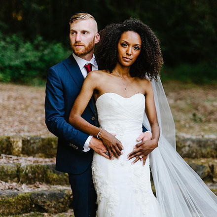 Newlywed portrait with groom wearing a blue INDOCHINO suit.