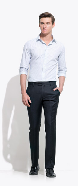 A model wearing an INDOCHINO pin-stripe custom shirt and black pants.