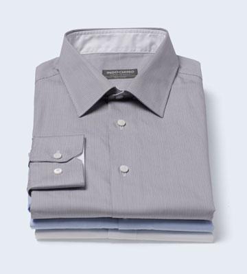 A stack of three INDOCHINO premium custom shirts.