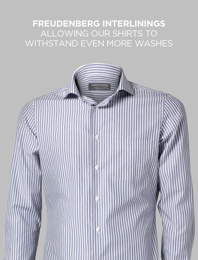A blue pin-striped INDOCHINO custom shirt.