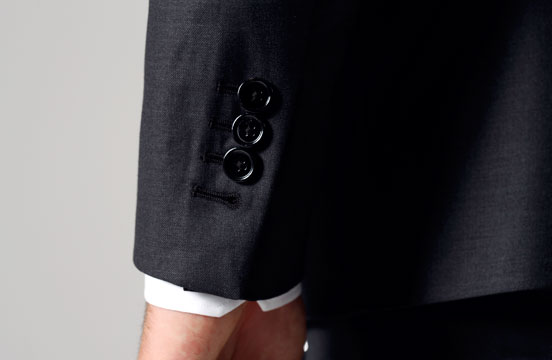 Close up of a cuff on INDOCHINO suit jacket.