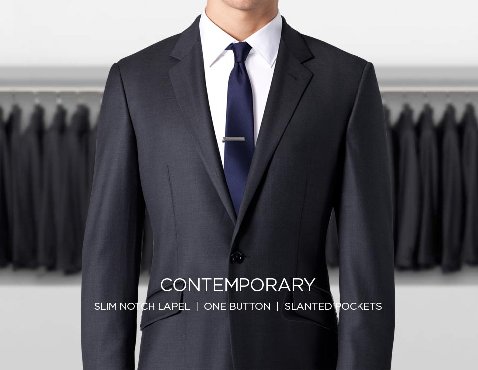 A contemporary suit with a slim notch lapel, one button and slanted pockets.