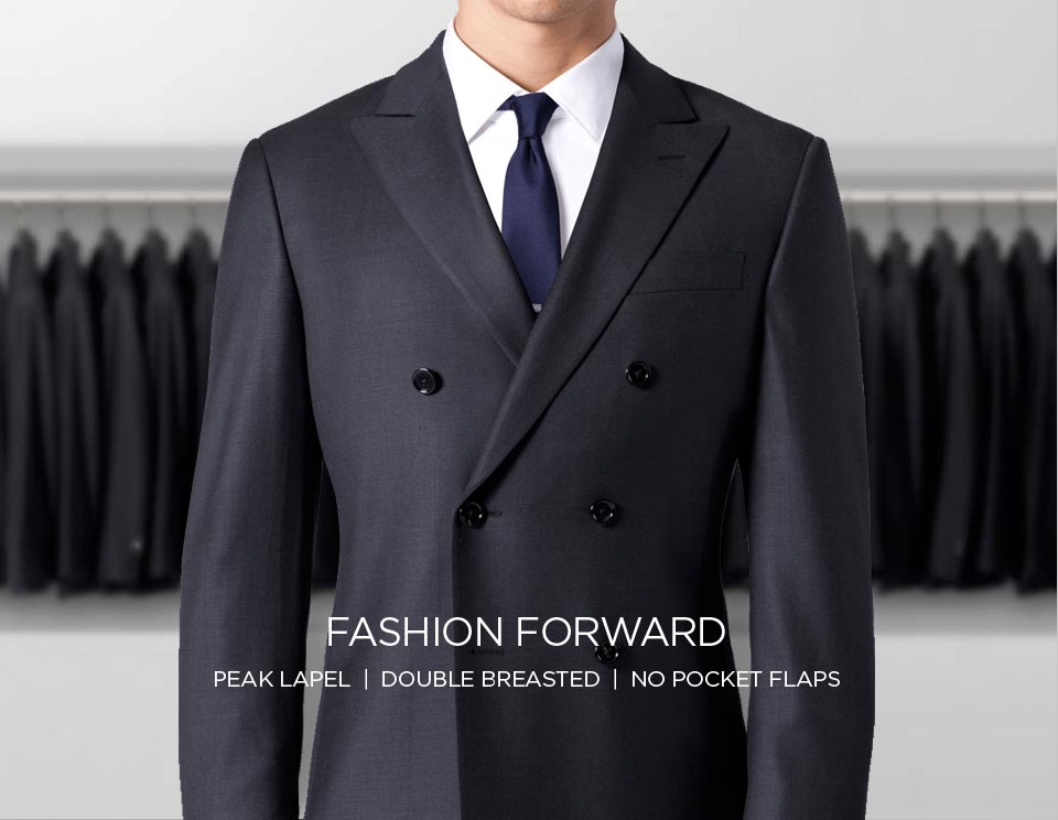 A fashion forward double breasted suit with a peak lapel and no pocket flaps.