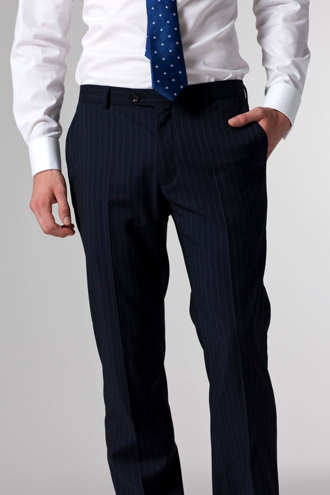 The blue pinstripe is a very light shade, almost white looking. The fabric has some stretch to it and since the pants are unlined, they have a little more give to them compared to some of the lined suit pants .